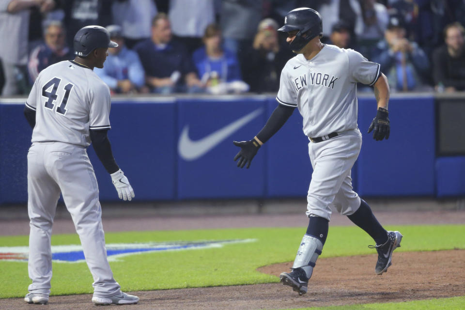 New York Yankees Gary Sanchez, right, celebrates his two=run home run with Miguel Andujar during the seventh inning of the team's baseball game against the Toronto Blue Jays, Wednesday, June 16, 2021, in Buffalo, N.Y. (AP Photo/Jeffrey T. Barnes)