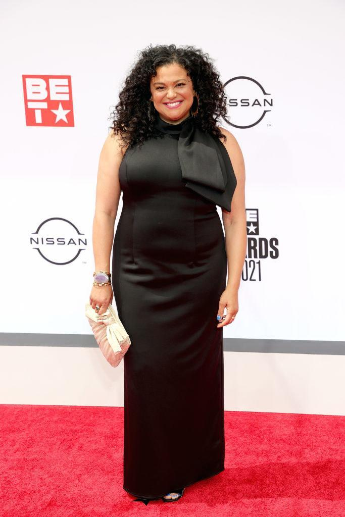 Michelle Buteau attends the BET Awards 2021 in a long halter dress