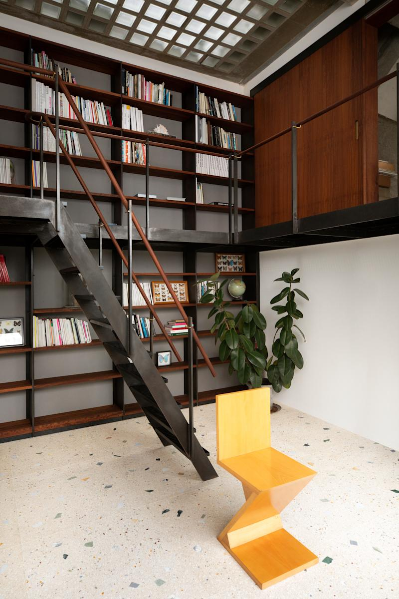 Chong transformed an extra bedroom into a library (he mostly reads art books) with a wraparound walkway and staircase. A yellow Gerrit Rietveld chair adds a pop of color against the custom terrazzo floor.