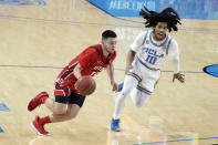 Utah guard Rylan Jones, left, dribbles past UCLA guard Tyger Campbell (10) during the first half of an NCAA college basketball game Thursday, Dec. 31, 2020, in Los Angeles. (AP Photo/Marcio Jose Sanchez)
