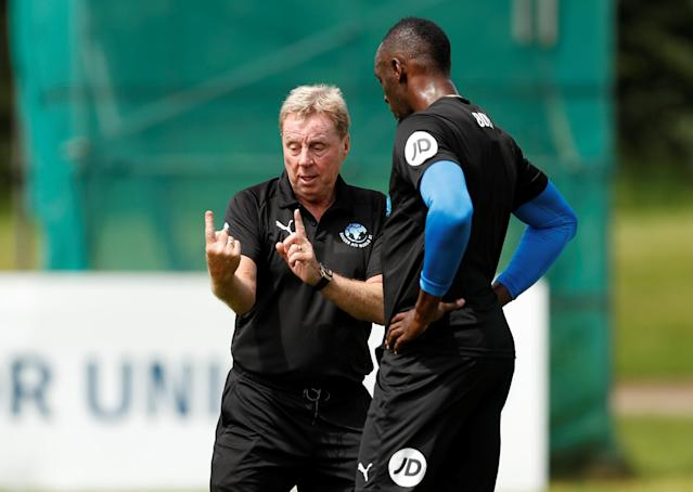 Soccer Football - England & Soccer Aid World XI Training - Motspur Park, London, Britain - June 8, 2018 Soccer Aid World XI's Usain Bolt with Harry Redknapp during training Action Images via Reuters/Andrew Boyers