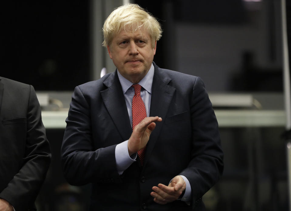 Britain's Prime Minister and Conservative Party leader Boris Johnson applauds during the Uxbridge and South Ruislip constituency count declaration at Brunel University in Uxbridge, London, Friday, Dec. 13, 2019. (AP Photo/Kirsty Wigglesworth)