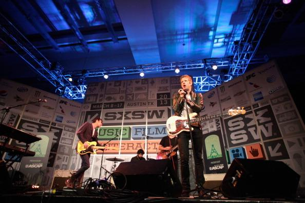 Music group Divine Fits performs onstage at Radio Day Stage during the 2013 SXSW Music, Film + Interactive Festival at Austin Convention Center on March 15, 2013 in Austin, Texas.