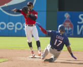 Cleveland Indians' Francisco Lindor forces Texas Rangers' Shin-Soo Choo out at second base during the fourth inning of the second game of a baseball doubleheader in Cleveland, Wednesday, Aug. 7, 2019. (AP Photo/Phil Long)