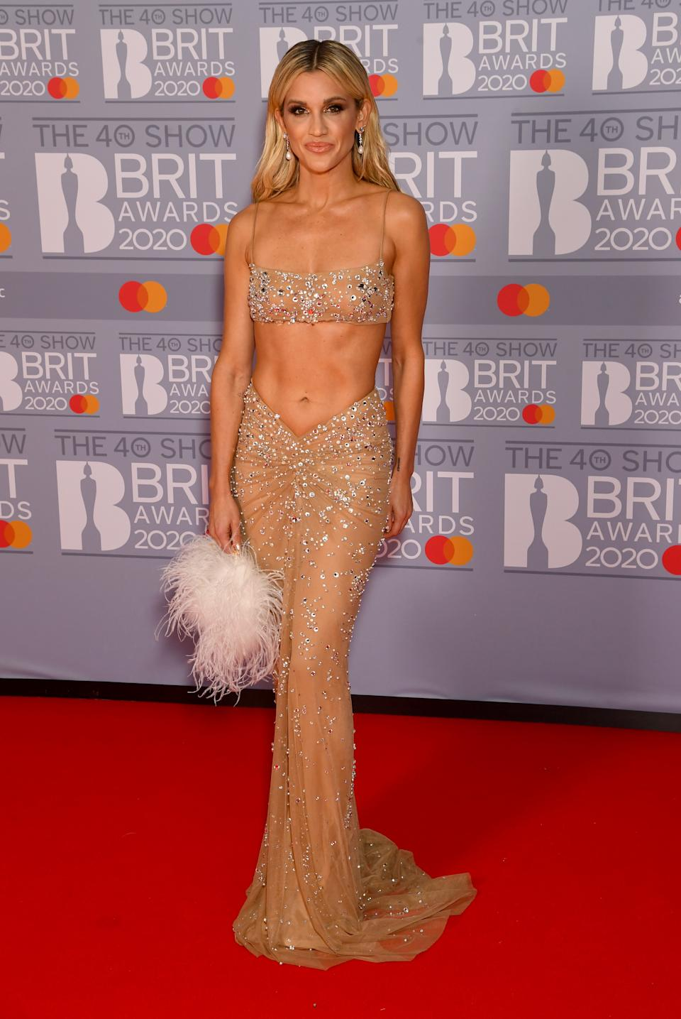 Ashley Roberts wears an ab-baring gown at The BRIT Awards 2020 at The O2 Arena on February 18, 2020 in London, England