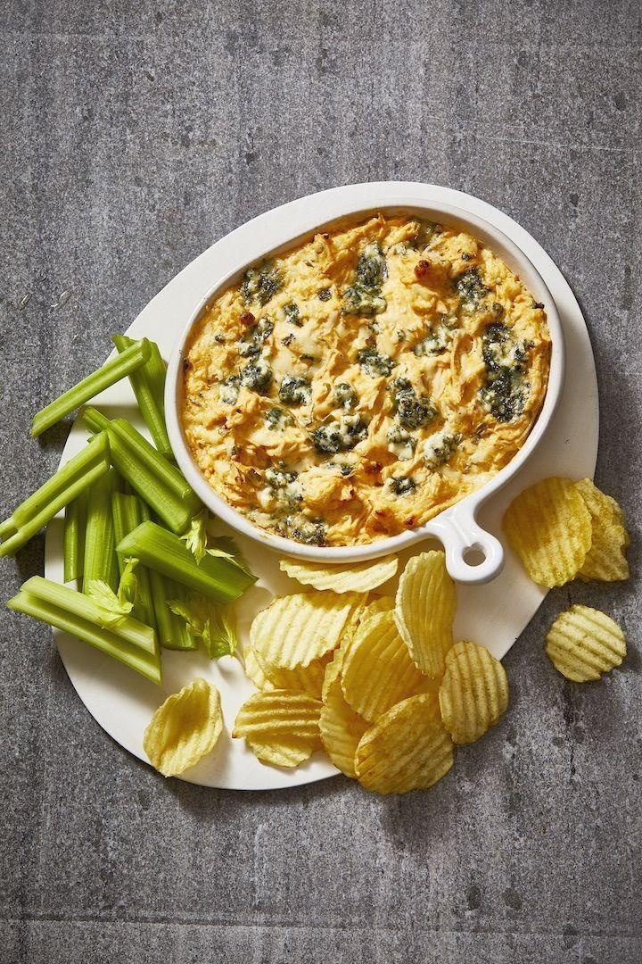"""<p>Easy and cheesy and loaded with hot sauce, this creamy dip is an ideal appetizer and should be served with a big bowl of chips.</p><p><em><a href=""""https://www.goodhousekeeping.com/food-recipes/a19738/buffalo-chicken-dip/"""" rel=""""nofollow noopener"""" target=""""_blank"""" data-ylk=""""slk:Get the recipe for Buffalo Chicken Dip »"""" class=""""link rapid-noclick-resp"""">Get the recipe for Buffalo Chicken Dip »</a><br></em></p><p><strong>RELATED:</strong> <a href=""""https://www.goodhousekeeping.com/food-recipes/party-ideas/g4967/easy-dip-recipes/"""" rel=""""nofollow noopener"""" target=""""_blank"""" data-ylk=""""slk:40 Best Dips That Will Win Over Every Party Guest"""" class=""""link rapid-noclick-resp"""">40 Best Dips That Will Win Over Every Party Guest</a></p>"""