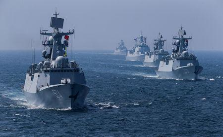 FILE PHOTO - A fleet of ships sail out at sea as China and Russia's naval joint drill concludes in Zhanjiang