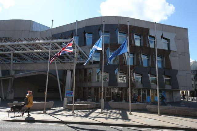Flags fly at half mast outside the Scottish Parliament in Edinburgh