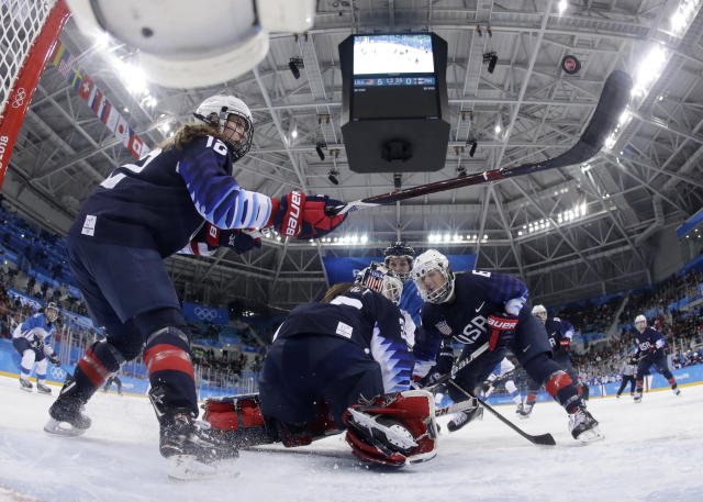 <p>Kelly Pannek (12), of the United States, tries to hit the puck during the third period of the semifinal round of the women's hockey game against Finland at the 2018 Winter Olympics in Gangneung, South Korea, Monday, Feb. 19, 2018. (Matt Slocum/Pool Photo via AP) </p>