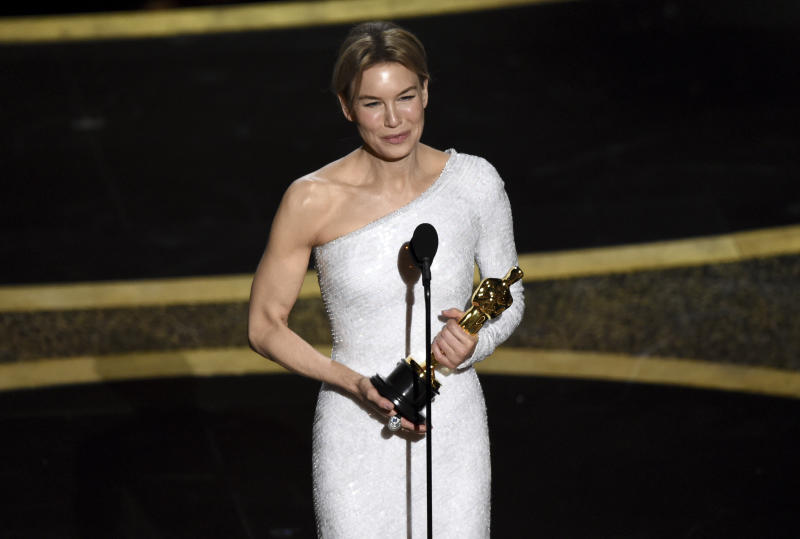 "Renee Zellweger accepts the award for best performance by an actress in a leading role for ""Judy"" at the Oscars on Sunday, Feb. 9, 2020, at the Dolby Theatre in Los Angeles. (AP Photo/Chris Pizzello)"