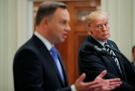 U.S. President Donald Trump listens to Poland's President Andrzej Duda during a joint news conference in the East Room of the White House in Washington, U.S., September 18, 2018. REUTERS/Brian Snyder