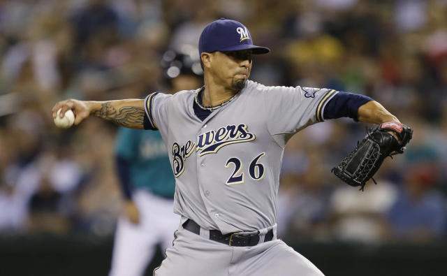 Milwaukee Brewers starting pitcher Kyle Lohse throws in the seventh inning of a baseball game against the Seattle Mariners, Friday, Aug. 9, 2013, in Seattle. (AP Photo/Ted S. Warren)