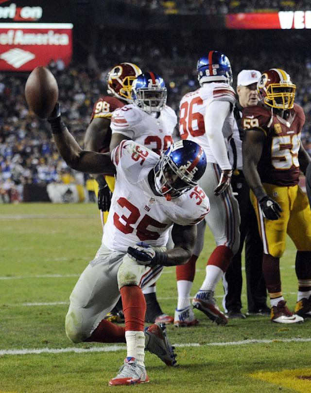New York Giants running back Andre Brown (35) celebrates his touchdown during the second half of an NFL football game against the Washington Redskins, Sunday, Dec. 1, 2013, in Landover, Md. (AP Photo/Nick Wass)