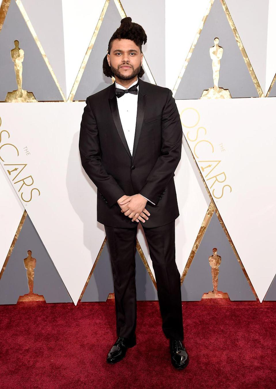 <p>The Oscars are nothing if not an opportunity to flex, so naturally Tesfaye turned up in a perfectly tailored shawl-collar tuxedo that whispers—so you have to lean in real close to listen—instead of shouts.</p>