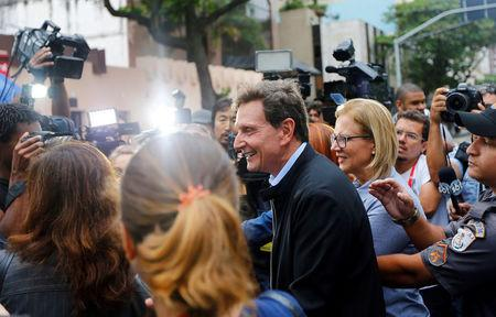 Senator Marcelo Crivella, candidate for Rio de Janeiro mayor, talks with journalists after voting the during municipal elections at a polling station in Rio de Janeiro, Brazil, October 30, 2016. REUTERS/Ricardo Moraes