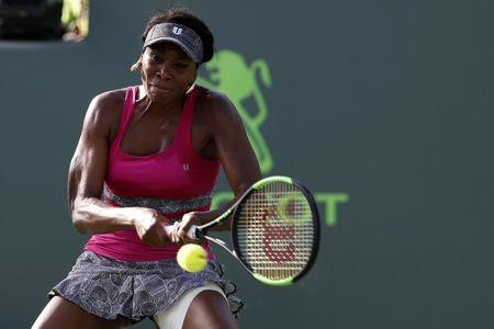 Mar 26, 2017; Miami, FL, USA; Venus Williams of the United States hits a backhand against Patricia Maria Big of Romania (not pictured) on day six of the 2017 Miami Open at Crandon Park Tennis Center. Mandatory Credit: Geoff Burke-USA TODAY Sports