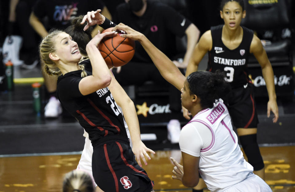 Stanford forward Cameron Brink (22) has her shot blocked by Oregon forward Nyara Sabally (1) during the first half of an NCAA college basketball game Monday, Feb. 15, 2021, in Eugene, Ore. (AP Photo/Andy Nelson)