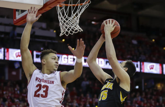 Iowa's Ryan Kriener (15) shoots past Wisconsin's Kobe King (23) during the first half of an NCAA college basketball game Thursday, March 7, 2019, in Madison, Wis. (AP Photo/Andy Manis)