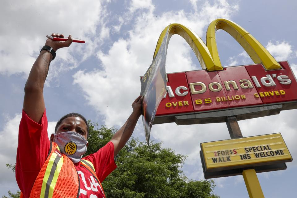 Strike for justice protesters are seen outside a McDonald's Monday, July 20, 2020, in Milwaukee. (AP Photo/Morry Gash)