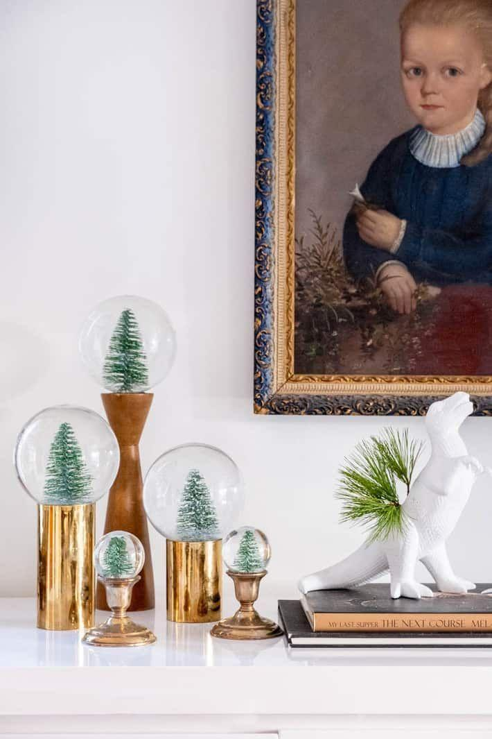 """<p>You've finally found an ingenious way to use up all your wine corks (they're keeping the solution inside the globe!). Group several snow globes on your foyer table or mantel for maximum impact.</p><p><strong>Get the tutorial at <a href=""""https://www.theartofdoingstuff.com/make-your-own-real-snow-globe/#mv-creation-42-jtr"""" rel=""""nofollow noopener"""" target=""""_blank"""" data-ylk=""""slk:The Art of Doing Stuff"""" class=""""link rapid-noclick-resp"""">The Art of Doing Stuff</a>.</strong></p><p><a class=""""link rapid-noclick-resp"""" href=""""https://www.amazon.com/Haiabei-Christmas-Crafting-Displaying-Decoration/dp/B07JLZ1SPV/ref=sr_1_2?dchild=1&keywords=tiny+bottle+brush+tree&qid=1631736808&refinements=p_72%3A1248915011&rnid=1248913011&s=home-garden&sr=1-2&tag=syn-yahoo-20&ascsubtag=%5Bartid%7C10050.g.2832%5Bsrc%7Cyahoo-us"""" rel=""""nofollow noopener"""" target=""""_blank"""" data-ylk=""""slk:SHOP TINY TREES"""">SHOP TINY TREES</a></p>"""