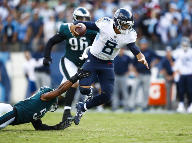 <p>Marcus Mariota #8 of the Tennessee Titans is defended by Jordan Hicks #58 of the Philadelphia Eagles during overtime at Nissan Stadium on Sept. 30, 2018 in Nashville, Tennessee. (Photo by Wesley Hitt/Getty Images) </p>
