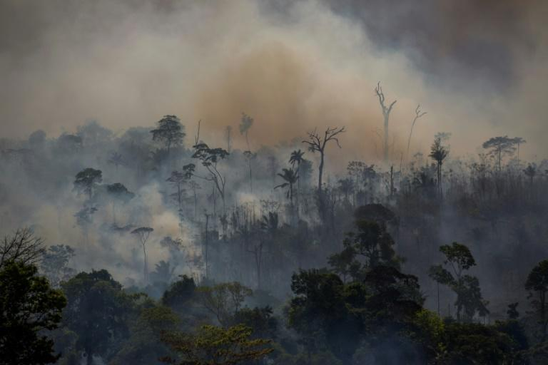 Smokes rises from forest fires in Altamira, Para state, Brazil, in the Amazon basin on August 27, 2019