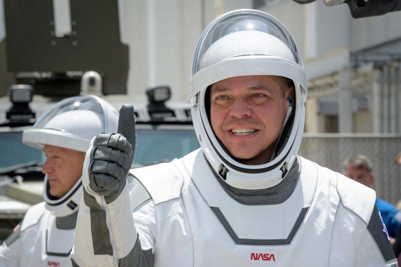 Robert Behnken (foreground) and Douglas Hurley, wearing SpaceX spacesuits ahead of their test flight (via REUTERS)