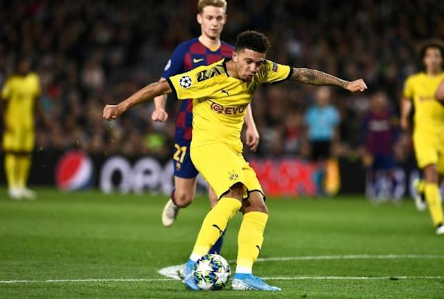 Jadon Sancho scored against Barcelona after starting the game on the bench for disciplinary reasons (AFP Photo/Josep LAGO)