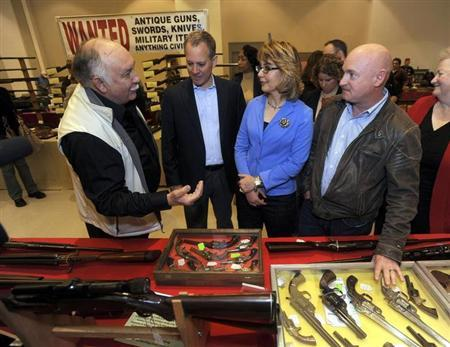 Show organizer Petronis leads Schneiderman, Giffords, and Kelly on a tour of the New Eastcoast Arms Collectors Associates arms fair in Saratoga Springs