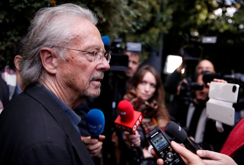 FILE PHOTO: Austrian author Peter Handke addresses the media, following the announcement he won the 2019 Nobel Prize in Literature, in Chaville