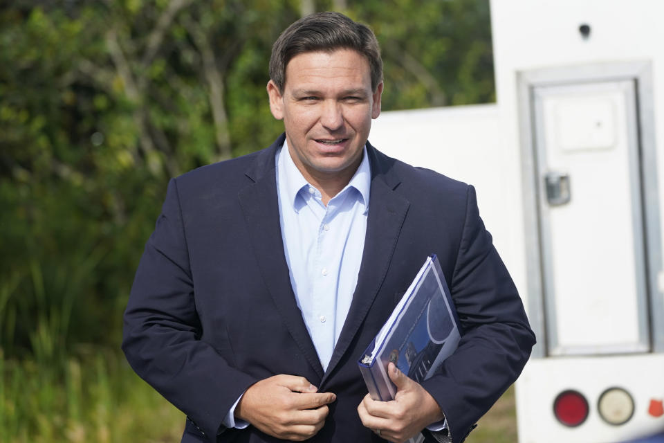 Florida Gov. Ron DeSantis arrives at a news conference, Tuesday, Aug. 3, 2021, near the Shark Valley Visitor Center in Miami. DeSantis is doubling down as the state again broke its record for COVID-19 hospitalizations. The Republican governor insisted Tuesday that the spike will be short-lived. (AP Photo/Wilfredo Lee)