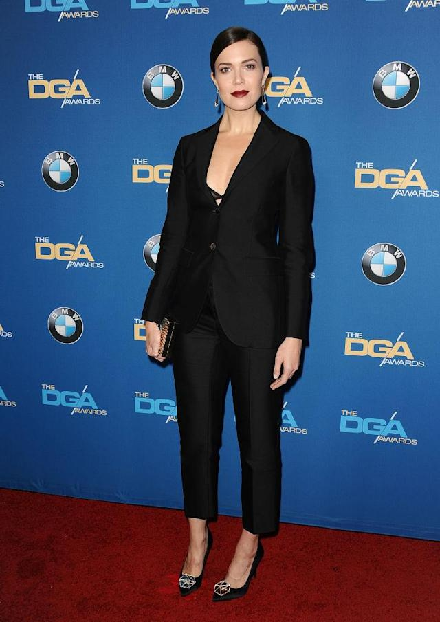 "Mandy Moore in a black Ferragamo tuxedo at the DGA Awards, with crisp tailoring and peekaboo bra. ""I love a good pantsuit. That was so much fun,"" she says. (Photo: Getty Images)"