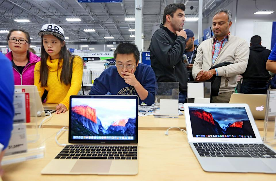 SAN DIEGO, CA - NOVEMBER 26:  Shoppers look over computer items at a Best Buy on November 26, 2015 in San Diego, California.  Although Black Friday sales are expected to be strong, many shoppers are opting to buy online or retailers are offering year round sales and other incentives that are expected to ease crowds. (Photo by Sandy Huffaker/Getty Images)