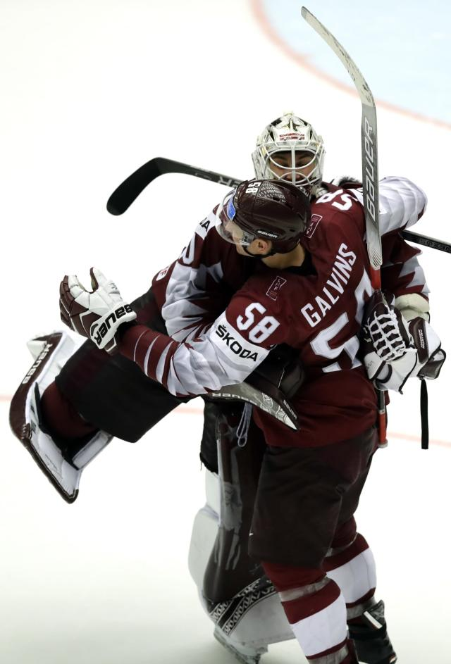 Ice Hockey - 2018 IIHF World Championships - Group B - Latvia v Denmark - Jyske Bank Boxen - Herning, Denmark - May 15, 2018 - Guntis Galvins of Latvia celebrates victory with goaltender Elvis Merzlikins of Latvia. REUTERS/David W Cerny