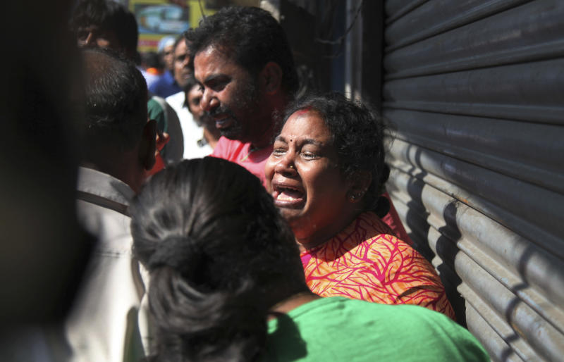 Relatives of passengers wail outside the office of a private bus operator, Jabbar Travels in Hyderabad, Andhra Pradesh state, India, Wednesday, Oct. 30, 2013 after their bus crashed into a highway barrier and erupted in flames early Wednesday. According to officials, many of the passengers were burned alive in the inferno. (AP Photo/Mahesh Kumar A.)