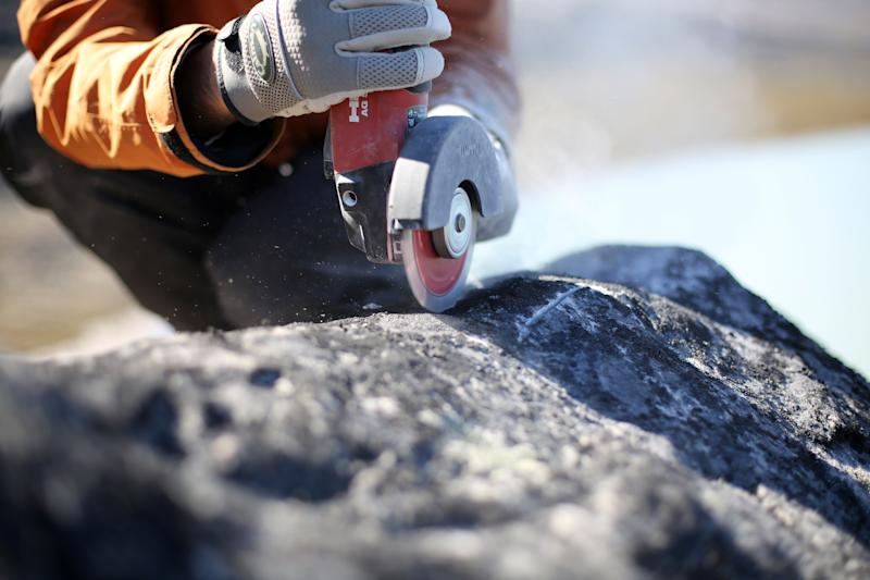 Scientists collecting samples from boulders in Greenland