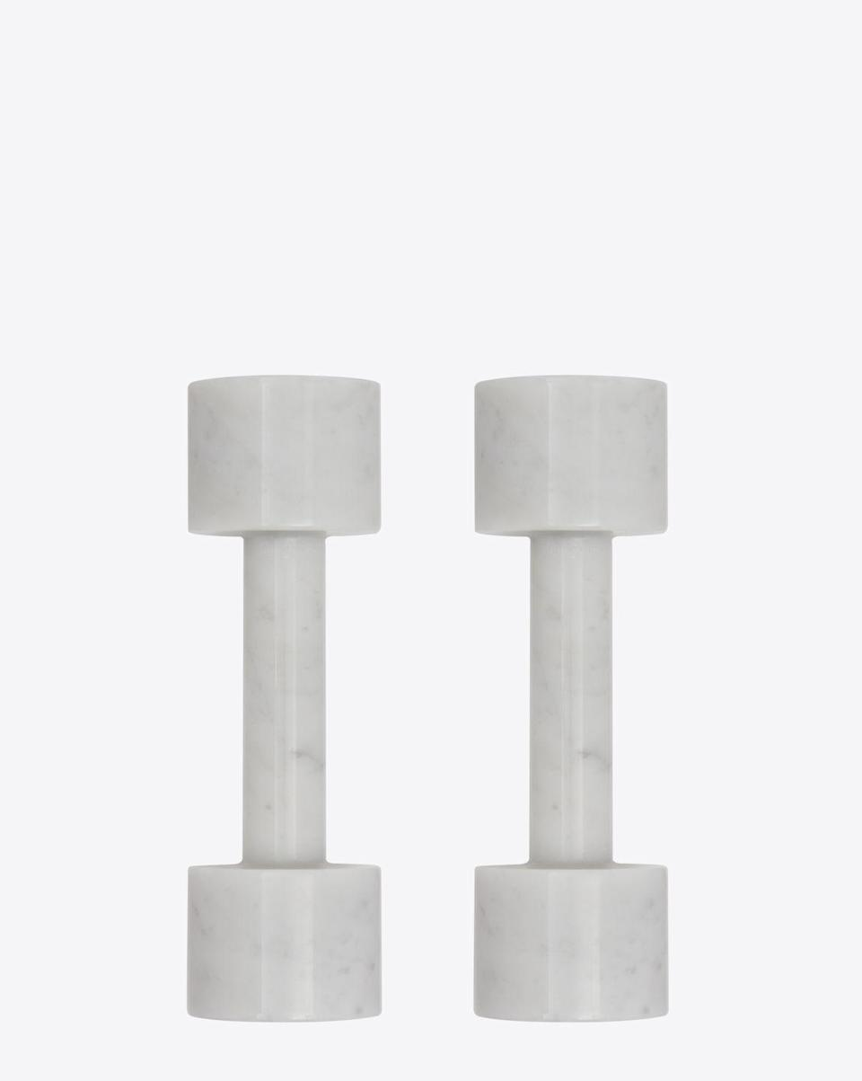 """<p>Minimal and hewn from Mother Nature herself, these YSL marble dumbbells almost look too good to use. Handcrafted and cut in Italy, the signature weights will make a slick and cool addition to any home gym – we'd even go as far as saying that the kit is a borderline art piece fit for the mantlepiece. </p><p>£1,125, <a href=""""https://www.ysl.com/en-gb/sport/dumbbells-in-marble-600484YCL029000.html"""" rel=""""nofollow noopener"""" target=""""_blank"""" data-ylk=""""slk:Yves Saint Laurent"""" class=""""link rapid-noclick-resp"""">Yves Saint Laurent</a>.</p>"""