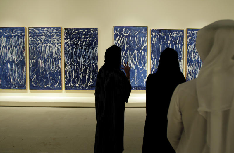 An Emirati guide describes an untitled piece by American artist Cy Twombly which is part of a sample collection at the Abu Dhabi branch of the Louvre in Abu Dhabi, United Arab Emirates, Tuesday, April 16, 2013. No artistic subjects will be off limits at the Abu Dhabi branch of the Louvre museum as it builds its collection for a planned 2015 opening, a top overseer said Tuesday, in a city seeking to broaden its international profile but testing how far to open its conservative culture. (AP Photo/Kamran Jebreili)
