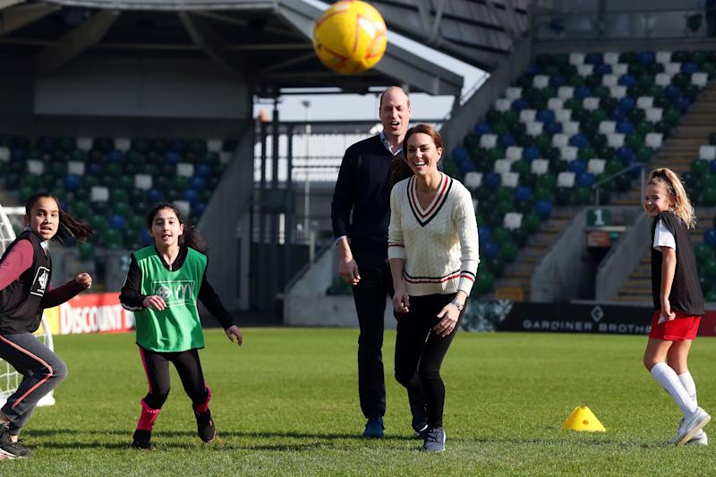 Kate and William play football at Windsor Park stadium in Northern Ireland in February. [Photo: Getty]