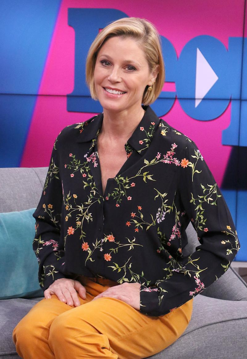 Julie Bowen looks stunning in a flowered design shirt and yellow color pant to match