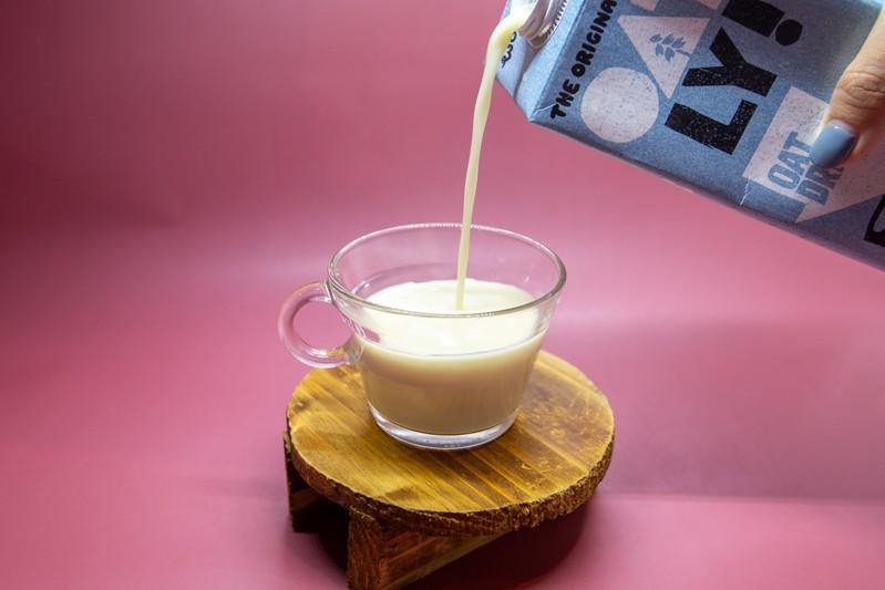 pouring shot of oatly