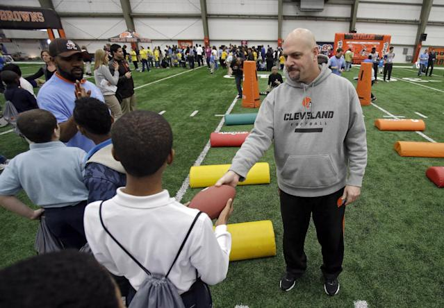 Cleveland Browns head coach Mike Pettine, right, works with area Special Olympians at the NFL team's Play 60 football festival at their facility in Berea, Ohio, Thursday, Feb. 13, 2014. Pettine replaced Mike Chudzinski, who was fired at the and of the 2013 season. (AP Photo/Mark Duncan)