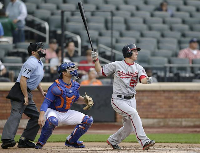 Washington Nationals' Adam LaRoche follows through a second-inning solo home run off New York Mets starting pitcher Aaron Harang in a baseball game Thursday, Sept. 12, 2013, in New York. (AP Photo/Kathy Willens)