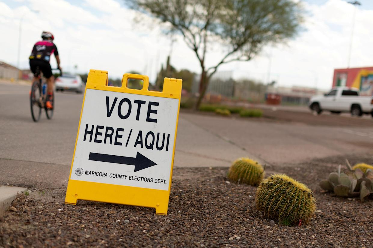 A sign points voters to a voting center for the Democratic primary in Sun City, Arizona, U.S., March 17, 2020.  (Cheney Orr/Reuters)