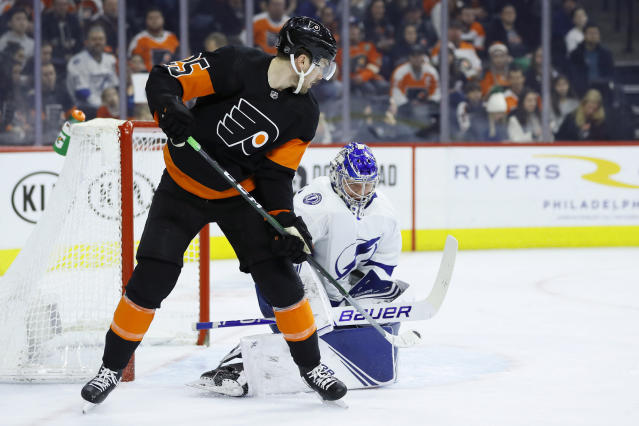 Tampa Bay Lightning's Andrei Vasilevskiy, right, blocks a shot as Philadelphia Flyers' James van Riemsdyk looks on during the second period of an NHL hockey game, Saturday, Jan. 11, 2020, in Philadelphia. (AP Photo/Matt Slocum)