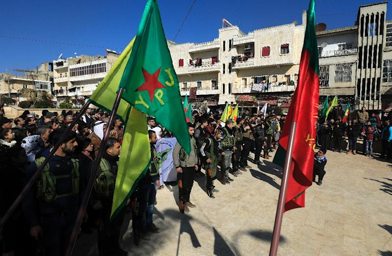 Syrian-Kurds attend an impromptu parade in Afrin as civilians enlist to fight an assault by Turkish troops and allied rebels on the Kurdish People's Protection Units (YPG) in Syria's border region on January 28, 2018
