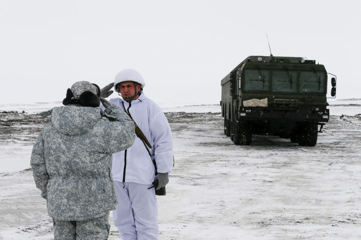 An officer on duty salutes reporting to another officer as the Bastion anti-ship missile systems take positions on the Alexandra Land island near Nagurskoye, Russia, Monday, May 17, 2021. Once a desolate home mostly to polar bears, Russia's northernmost military outpost is bristling with missiles and radar and its extended runway can handle all types of aircraft, including nuclear-capable strategic bombers, projecting Moscow's power and influence across the Arctic amid intensifying international competition for the region's vast resources. (AP Photo/Alexander Zemlianichenko)