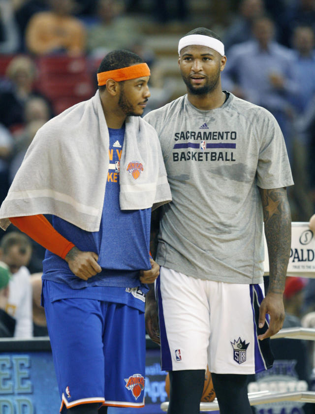 Sacramento Kings center DeMarcus Cousins, right, and New York Knicks forward Carmelo Anthony visit during halftime of an NBA basketball game in Sacramento, Calif., on Wednesday, March 26, 2014.The Knicks won 107-99.(AP Photo/Steve Yeater)