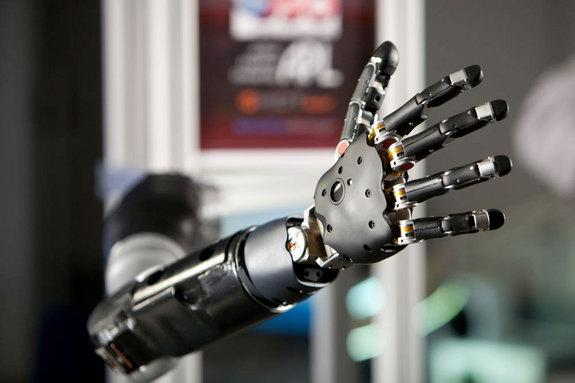 the prosthetic arm, designed by the John Hopkins University's Applied Physics Laboratory (JHU/APL) and funded by the U.S. Department of Defense's Defense Advanced Research Projects Agency (DARPA).