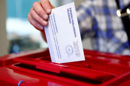 A man casts his vote during European Parliament election in Riga